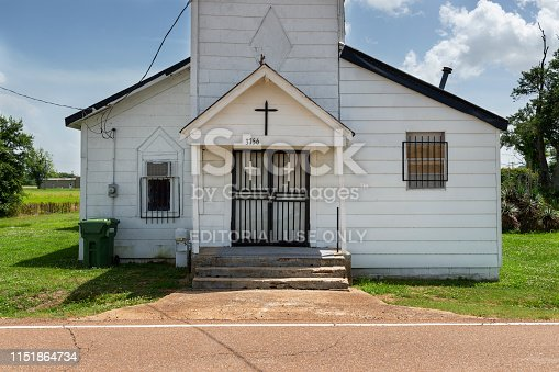 Tunica, Mississippi, USA - June 23, 2014: The facade of an old baptist church at the Cobb Road near Tunica, Mississippi