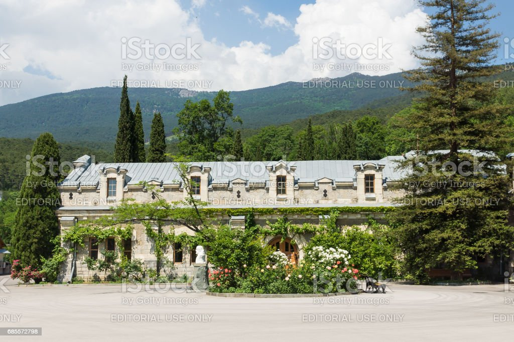 the Facade of one of buildings of the wine factory 'Massandra' in the Crimea on the background of beautiful mountains stock photo