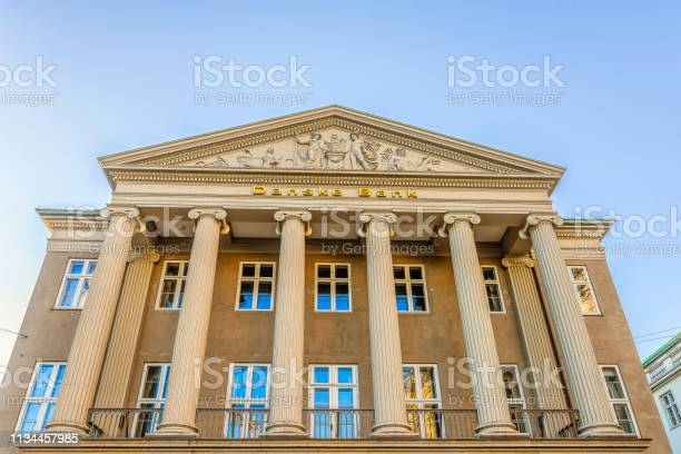 The facade of the money laundering danish bank with ionic columns and picture id1134457985?b=1&k=6&m=1134457985&s=612x612&h=whfkuedwym2evtok8brmipmf7o0jo7gozvc9xgy1674=
