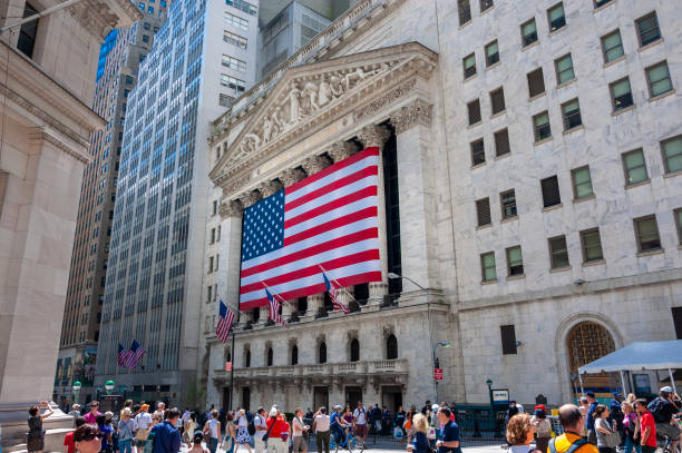 the facade of the new york stock exchange in wall street - new york stock exchange stock pictures, royalty-free photos & images