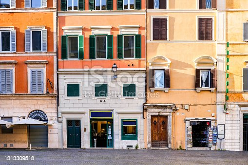 istock The facades in the square of Santa Maria in Trastevere in the heart of Rome 1313309518