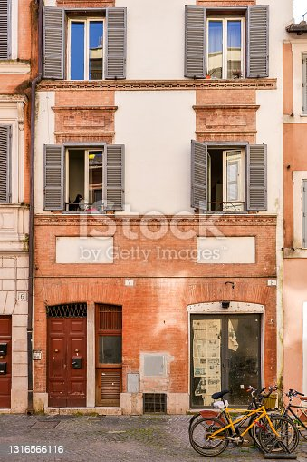 The facades of some ancient townhouses along Borgo Pio street, near the Vatican City and the square of the St. Peter's Basilica, one of the most frequented places by the millions of tourists who visit Rome every year. Image in high definition format.