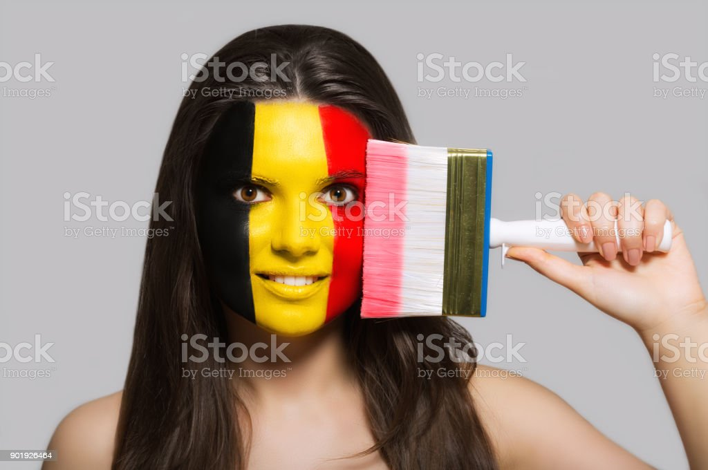 The face of a woman in the national colors of Belgium stock photo