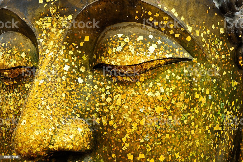 The face of Bronze Buddha. stock photo