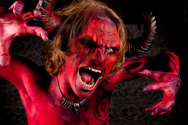 the face of evil - demon fictional character stock photos and pictures