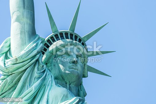 The Statue of Liberty looks east over the New York Harbor.