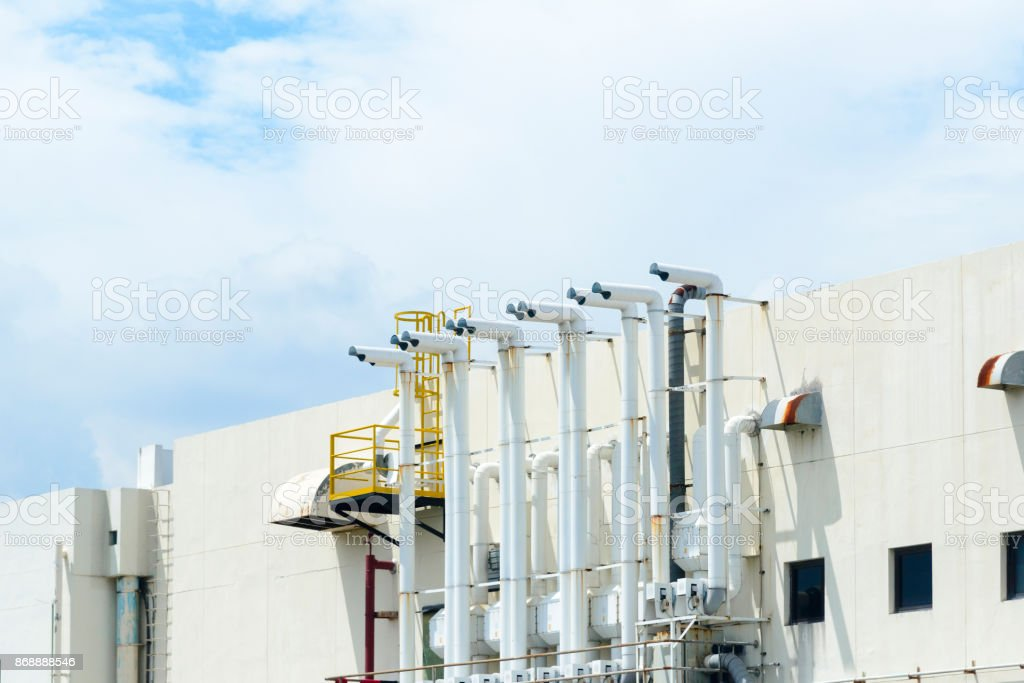 The factory building and the smoke stack stock photo