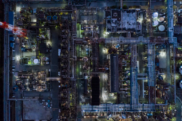 The factory zone is accompanied by light at night as well stock photo