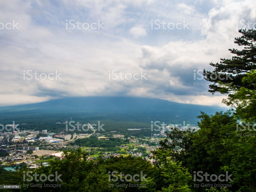 The failure moment to see the big great valcano mountain in Japan named Fuji, the myst of fog is block the whole peak edge of the mountain. Anyway, the amusement park could still be seen stock photo