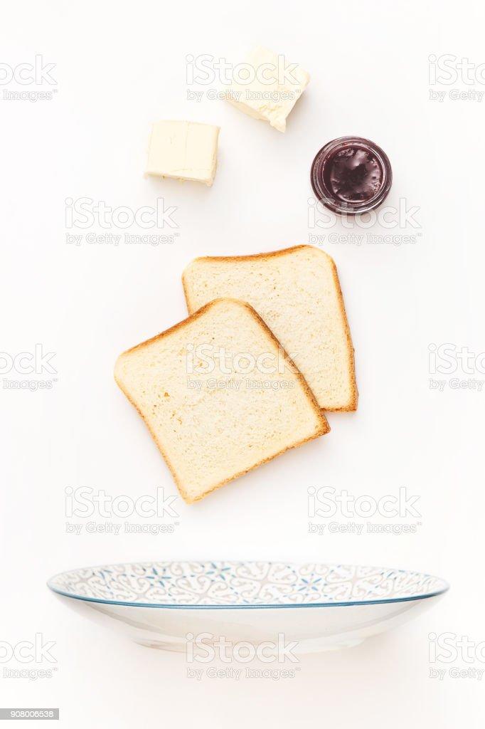 The falling ingredients of fried toastes. Healthy breakfast ingredients stock photo