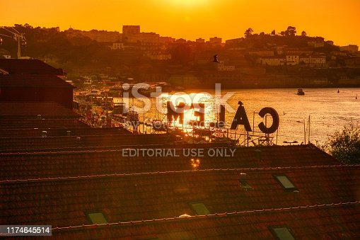 Porto, Portugal - September 7, 2019: View of the waterfront and the old city of Vila Nova de Gaia, Portugal. The famous Calem wine lodge, museum, cellars and taste of local port wine.