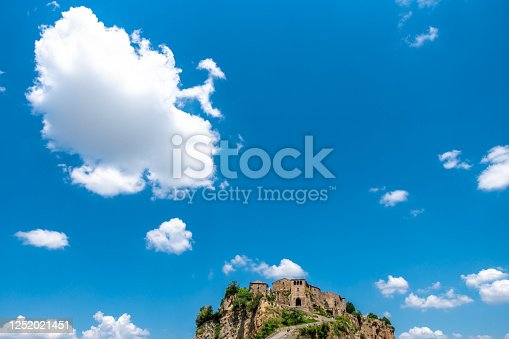 The famous Civita di Bagnoregio surrounded by a cloudy summer sky, Lazio, Italy