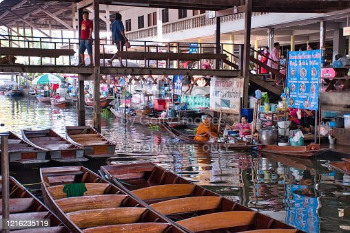 Damnoen Saduak, Thailand, 12.22.2019: The Famous Damnoen Saduak Floating Market with fruits, vegetables, foods and different items sold from small boats. Until recently, the main form of trade