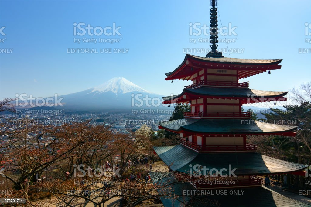 The famous five-storied Chureito Pagoda stands in front of Mount Fuji on a warm spring day in Japan royalty-free stock photo