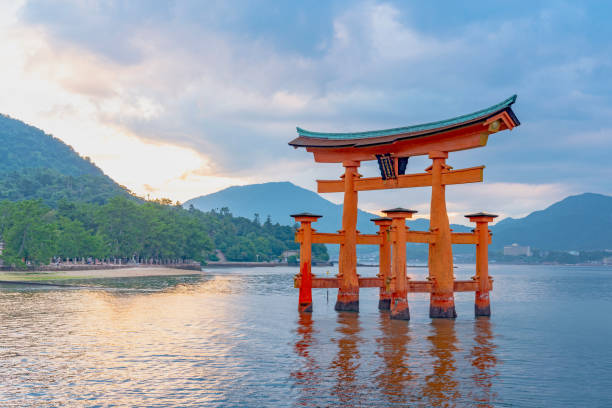 The famous floating great torii gate Hatsukaichi, HIROSHIMA, JAPAN - September 16 : The famous floating great torii gate in Itsukushima shrine itsukushima shrine stock pictures, royalty-free photos & images