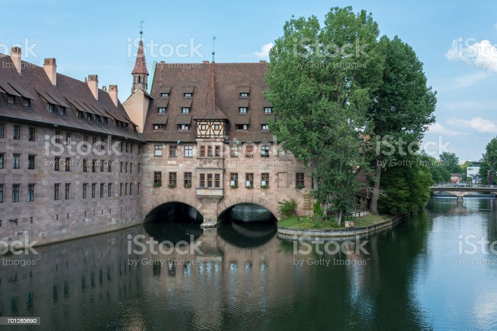 The famous 'Heilig Geist Spital' in the middle of the old town of Nuremberg, Germany stock photo