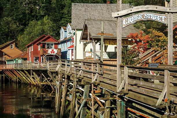 The famous historic Creek Street in Ketchikan Alaska The famous historic Creek Street, formerly brothels, home of the famous Dolly the madam, in Ketchikan Alaska. A popular tourist shopping destination, especially for cruise ships. ketchikan stock pictures, royalty-free photos & images