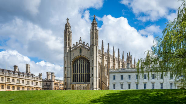 the famous king's college chapel from the bank of river cam on a bright sunny day - cambridge university stock photos and pictures