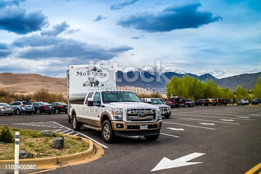 Great Sand Dunes NP, CO, USA - May 5, 2017: The F350 Ford with a trailer parked along the preserved park