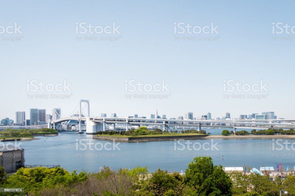 The famous rainbow bridge that cross from Tokyo to Odaiba island. stock photo