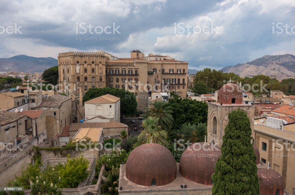 The famous red domes of the Church of St. John of the Hermits (San Giovanni degli Eremiti) and the Norman Palace (Palazzo dei Normanni) - Palermo, Sicily, Italy stock photo