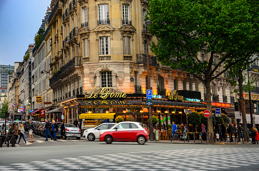 Paris, France - circa May, 2017: The famous restaurant Le Dome on Montparnasse boulevard in Paris. Opened in 1898 it was frequented by famous sculptors, writers and painters