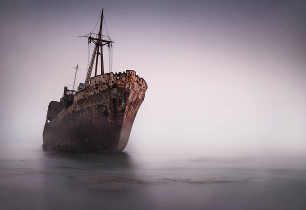 the famous rusty shipwreck near gytheio at sunset - shipwreck stock pictures, royalty-free photos & images