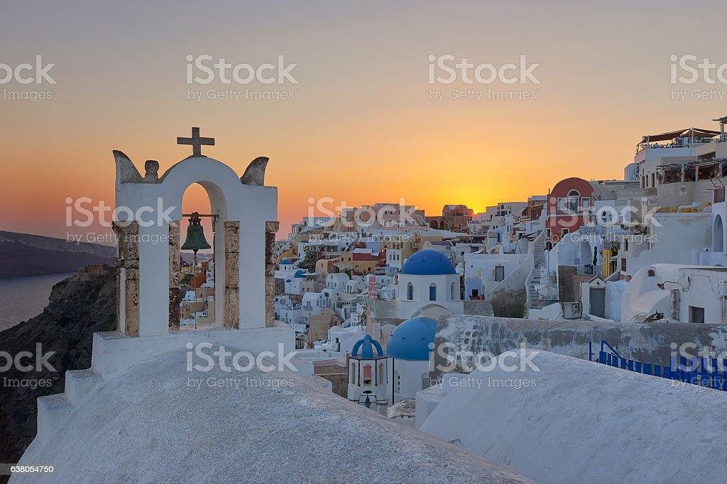 The famous Santorinian sunset stock photo