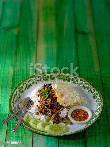 This delicious dish is made of fresh minced pork, cooked in hot oil in a wok mixed with fresh holy basil, fresh chili, onion and garlic with seasoning. This dish is normally served on top of fresh steamed rice with a fried egg, sliced cucumber and chili with fish sauce as complements to the dish. This popular Thai recipe is found across Thailand being recognized as a quick tasty dish, it can be ordered in restaurants but is well known for being a popular street food dish.