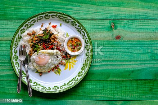 This delicious dish is made of fresh minced pork, cooked in hot oil in a wok mixed with fresh holy basil, fresh chili, onion and garlic with seasoning. This dish is normally served on top of fresh steamed rice with a fried egg and chili with fish sauce as complements to the dish. This popular Thai recipe is found across Thailand being recognized as a quick tasty dish, it can be ordered in restaurants but is well known for being a popular street food dish.