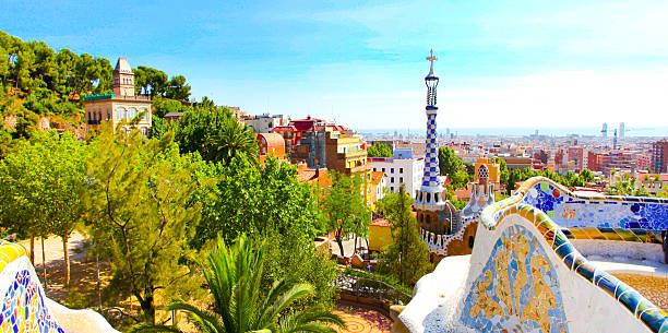 The Famous Summer Park Guell over bright blue sky The Famous Summer Park Guell over bright blue sky in Barcelona, Spain passeig de gracia stock pictures, royalty-free photos & images