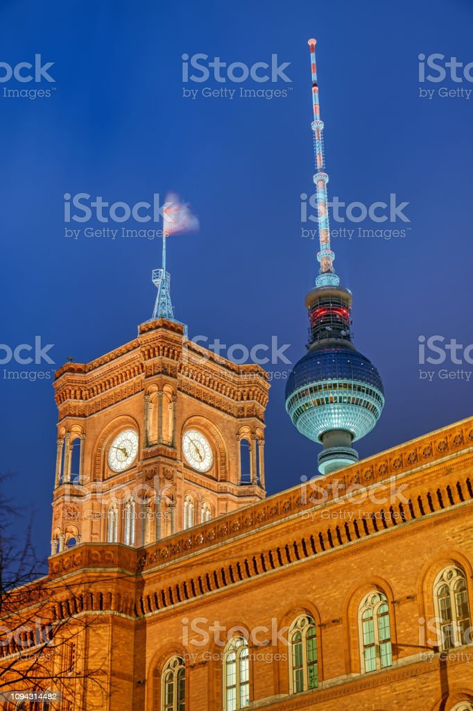 The famous Television Tower and the tower of the city hall stock photo