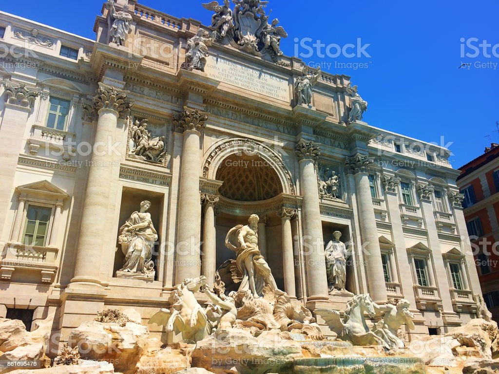 The famous Trevi Fountain, adjacent to the facade of Palazzo Poli. Rome. Italy stock photo