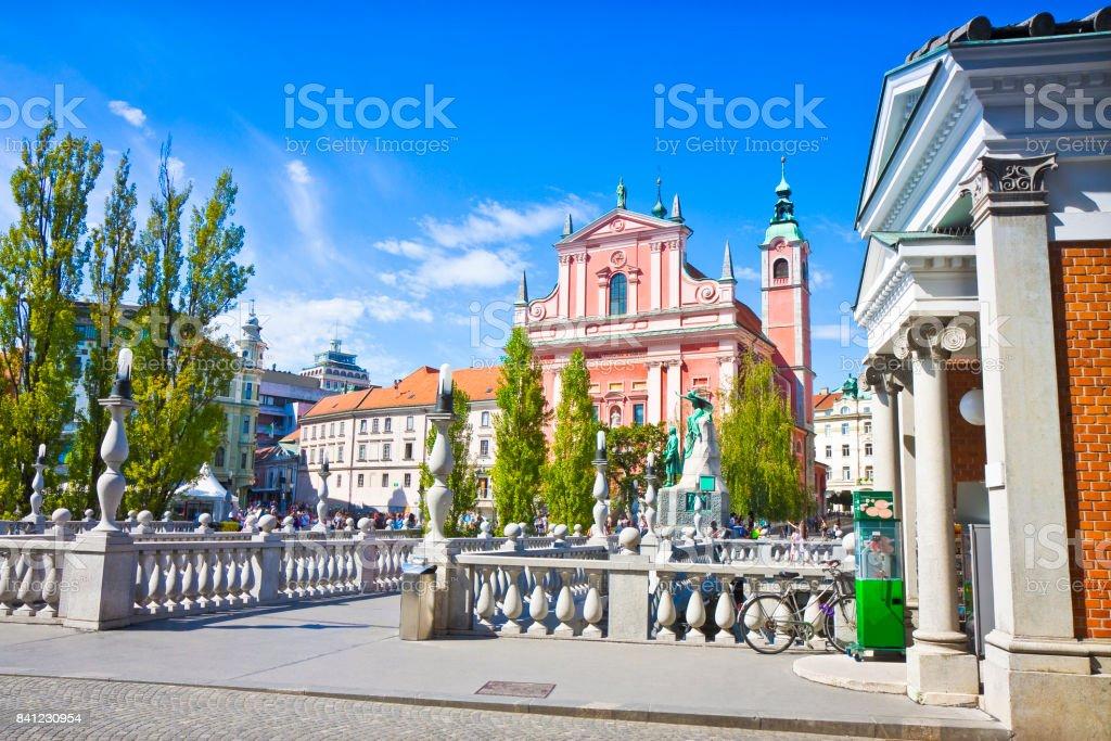 The famous 'Triple Bridge' on Ljubljanica river (Ljubljana city center - Slovenia - Europe) - People are not recognizable. stock photo