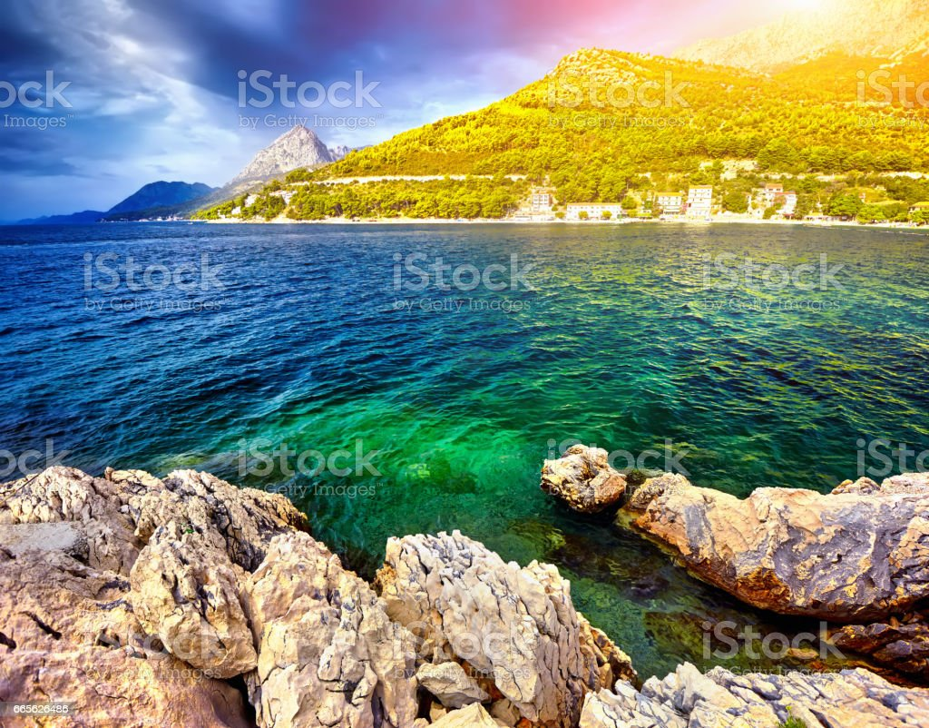 The Fantastic views of the adriatic sea under sunlight and blue stock photo