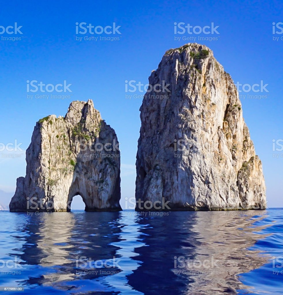 The Faragolini Rock Formations off the Island of Capri Italy. stock photo
