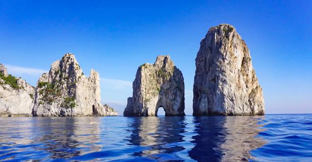 The Faragolini Rock Formations off the Island of Capri Italy. stock photo