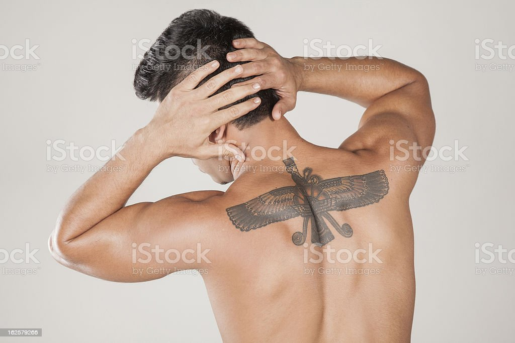 The fashion model with persian style tattoo - Farvahar royalty-free stock photo