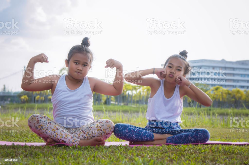 the fat girl and thin girl playing have fun in the park , child girl baby have fun fat and thin stock photo
