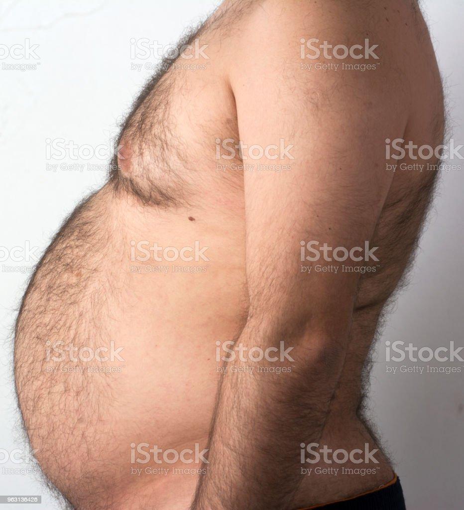 Den feta mannens mage - Royaltyfri Banta Bildbanksbilder