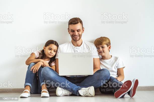 The father and kids with a laptop sitting on the floor picture id1060219198?b=1&k=6&m=1060219198&s=612x612&h=nfnuj7trizriujvplvacxiosxv7fd2pyetqhofwvph0=