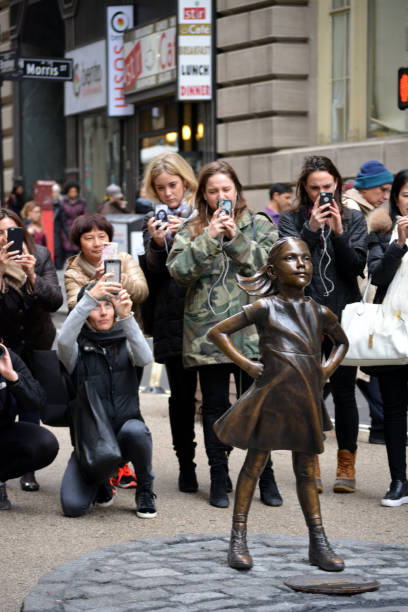 the fearless girl - courage stock photos and pictures