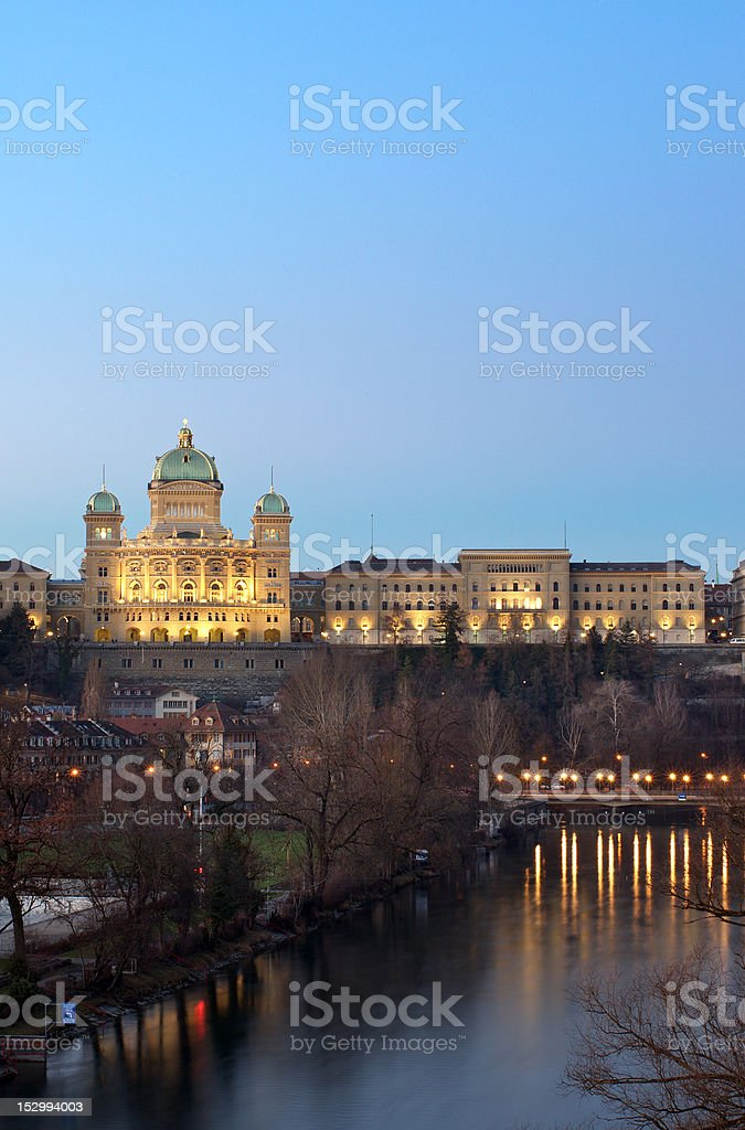 The Federal Palace of Switzerland behind aar river at dusk royalty-free stock photo