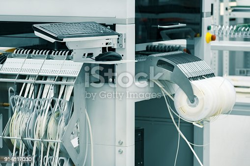 istock The feeder of pick and place machine 914817030