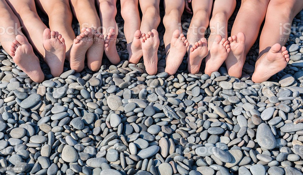 The feet of children on the beach. royalty-free stock photo