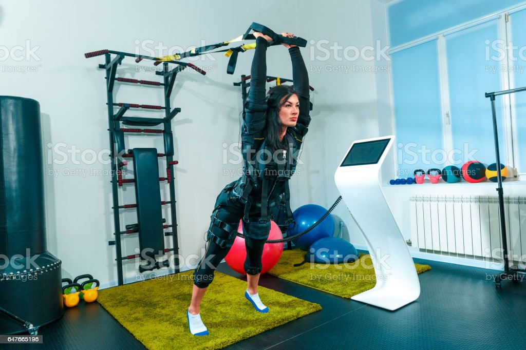 The female athlete doing they exercise in a ems fitness studio stock photo