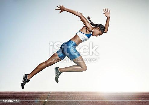 istock The female athlete running on runing track 610667484
