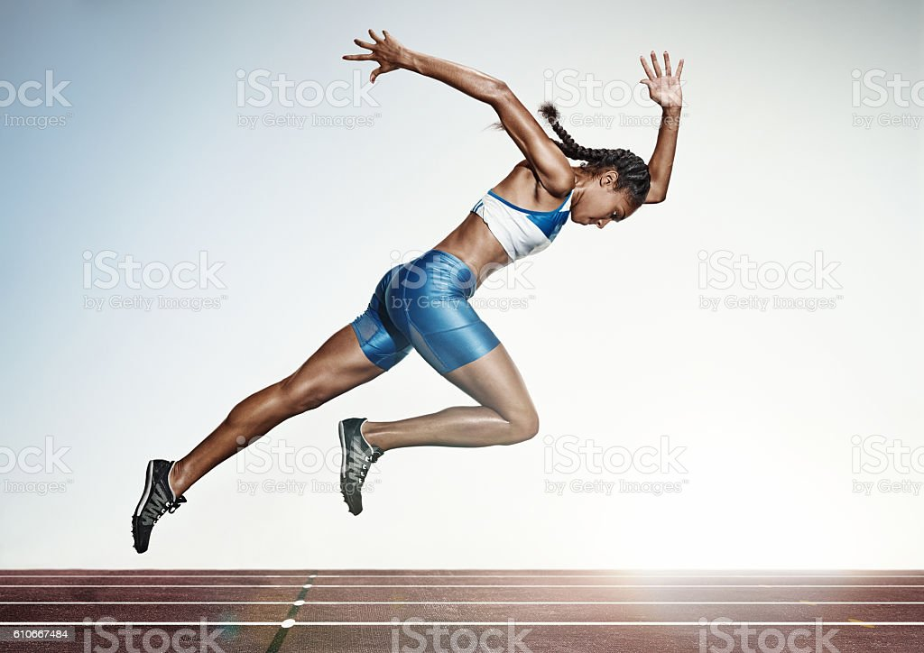 The female athlete running on runing track stock photo