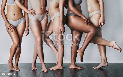 Studio shot of unrecognizable women posing against a grey background
