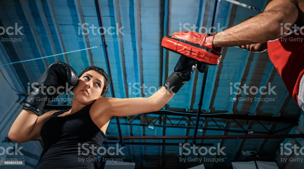 The female boxer and afro american male boxer stock photo